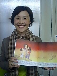 Tomoko Watanabe holding a copy of Sadako's Prayer