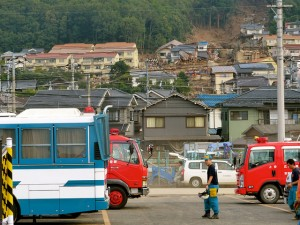 Emergency vehicles at the scene of the Hiroshima mudslide disaster